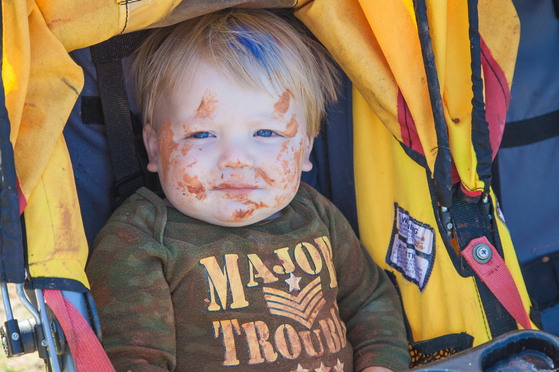 Even the toddler has mud on his face at the Chamblee Fun Mud Run, 5K.