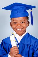 Studio Cap & Gown Graduation Photos on a blue background for Kindergarten graduation
