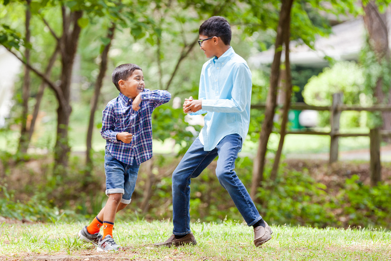 Boys playing outside on a spring day at Murphey Candler Park