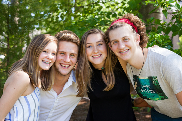 Photos of 4 teenage cousins outside in a group hug