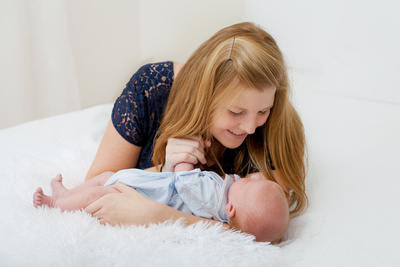 Newborn baby boy with his mom in studio