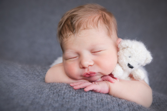 Newborn Portraits with mom, dad and baby in Brookhaven Studio