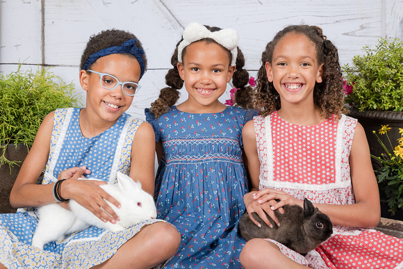 3 Sisters holding bunnies for an easter mini session inside studio