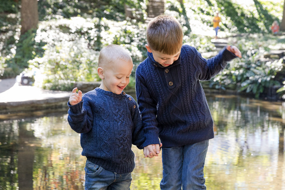 Fall photos with two brothers playing the edge of a pond in Midtown Atlanta