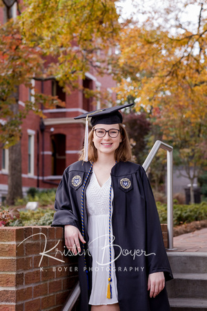 Gorgeous Young lady in a Cap and Gown for Senior Portrait photos in Front of Tech Tower at Georgia Tech