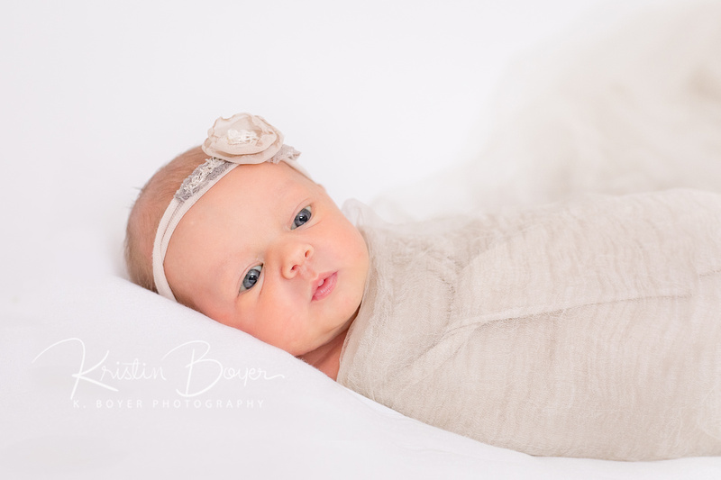 Atlanta Newborn portraits for a newborn baby girl and her two big sisters plus mom and dad