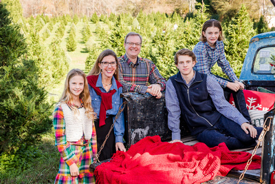 Family photos at the tree farm with an old blue truck