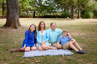 Mother and Father with son and daughter on the lawn at Barrington Hall in Roswell GA