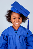 Studio Cap & Gown Graduation Photos on a blue background for Kindergarten graduation