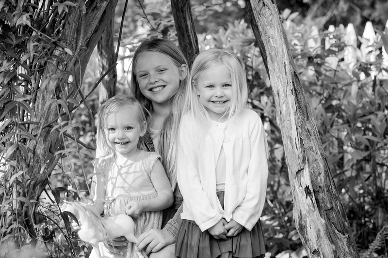 Outside family photos with three little girls in Historic Roswell GA