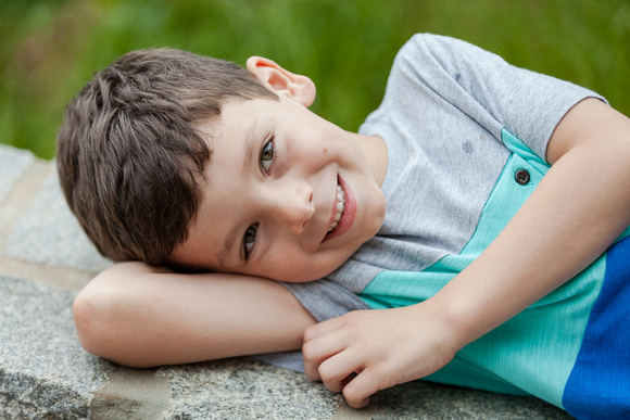 Outdoor family photos in a neighborhood park with two young boys and mom and dad