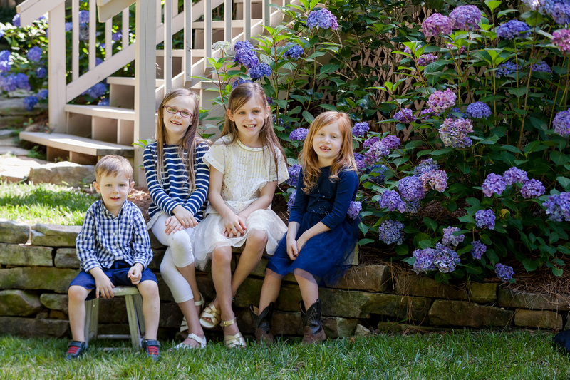 Family of six outside photo session, Playing in the backyard with swings, bubbles and laughter,