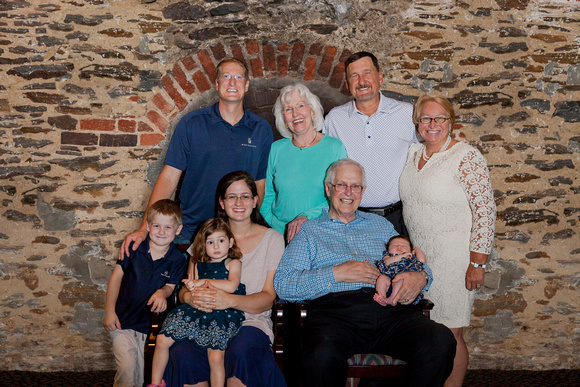 Family portraits in front of an old brick wall in Historic Roswell Mill, Roswell GA