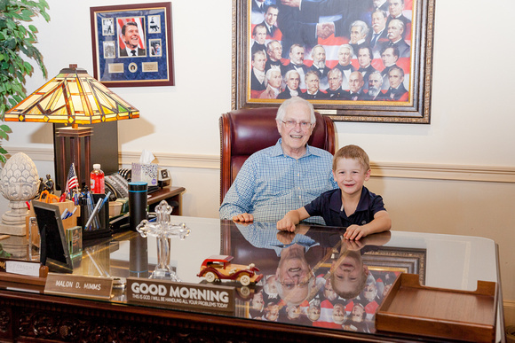 Family Portraits of the Mimm's Family sharing Great Grandfathers desk with his grandson