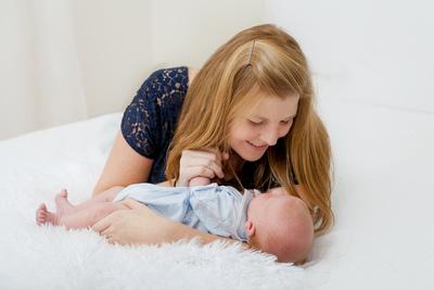 Newborn baby boy with his mom in studio